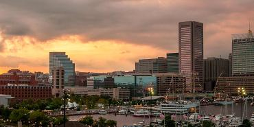 View of Baltimore skyline at sunset near the Inner Harbor