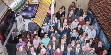 STScI employees group photo in Muller lobby