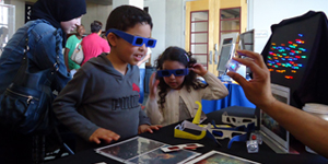 Children engaged in a STEM activity wearing filter glasses