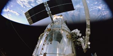 Image of Hubble Space Telescope during a servicing mission