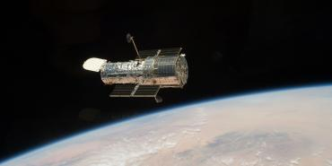 Hubble telescope in orbit as photographed during Servicing Mission 4