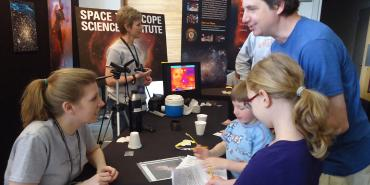 STScI staff engaging with public at Johns Hopkins University Fair