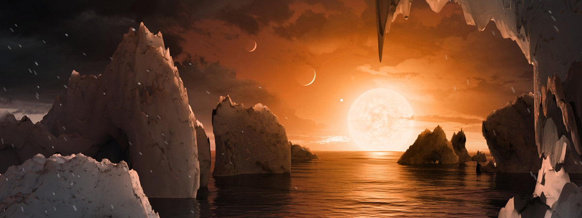 This artist's concept allows us to imagine what it would be like to stand on the surface of the exoplanet TRAPPIST-1f.